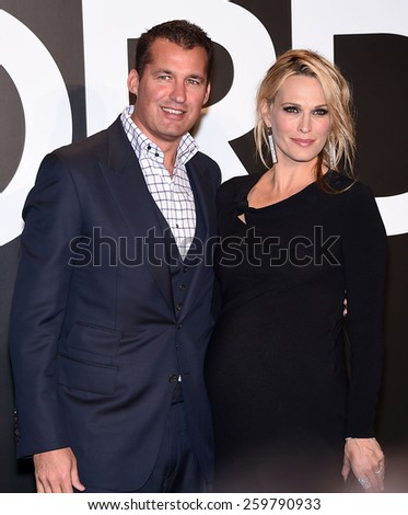 LOS ANGELES - FEB 20:  Molly Sims & Scott Stuber arrives to the Tom Ford Autumn/Winter 2015 Womenswear Collection Presentation  on February 20, 2015 in Hollywood, CA                 - stock photo