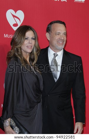 LOS ANGELES - FEB 10:  Rita WIlson,  Tom Hanks arrives at the 2012 MusiCares Gala honoring Paul McCartney at LA Convention Center on February 10, 2012 in Los Angeles, CA - stock photo