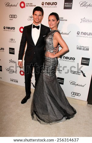 LOS ANGELES - FEB 22:  Robbie Amell, Italia Ricci at the Elton John Oscar Party 2015 at the City Of West Hollywood Park on February 22, 2015 in West Hollywood, CA - stock photo