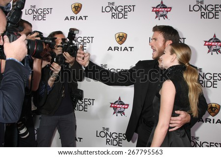 """LOS ANGELES - FEB 6:  Scott Eastwood, Britt Robertson at the """"The Longest Ride"""" Los Angeles Premiere at the TCL Chinese Theater on FEB 6, 2015 in Los Angeles, CA - stock photo"""
