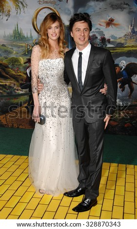 LOS ANGELES - FEB 13 - Taylor Bagley and Zach Braff arrives at the Oz The Great and Powerful World Premiere on February 13, 2013 in Los Angeles, CA              - stock photo
