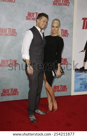 LOS ANGELES - FEB 18: The Miz, Maryse Ouellet at the 'Hot Tub Time Machine 2' premiere on February 18, 2014 in Los Angeles, California - stock photo