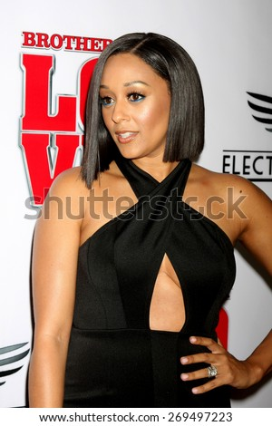 """LOS ANGELES - FEB 13:  Tia Mowry at the """"Brotherly Love"""" LA Premiere at the Silver Screen Theater at the Pacific Design Center on April 13, 2015 in West Hollywood, CA - stock photo"""