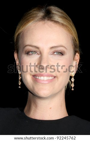 LOS ANGELES - JAN 7:  Charlize Theron arrives at the 2012 Palm Springs International Film Festival Gala at Palm Springs Convention Center on January 7, 2012 in Palm Springs, CA - stock photo