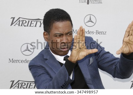 LOS ANGELES - JAN 4:  Chris Rock at the Variety's Creative Impact Awards and '10 Directors To Watch' Brunch at the Park Palm Springs on January 4, 2015in Palm Springs, CA - stock photo