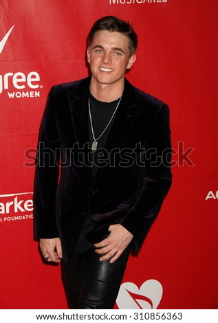 LOS ANGELES - JAN 24:  Jesse McCartney arrives at the 2014 MusiCares Person Of The Year Honoring Carole King  on January 24, 2014 in Los Angeles, CA                 - stock photo