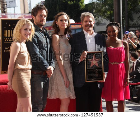 "LOS ANGELES - JAN 12:  John Wells & cast of ""Shameless"" arriving to Walk of Fame Ceremony for John Wells  on January 12, 2012 in Hollywood, CA - stock photo"