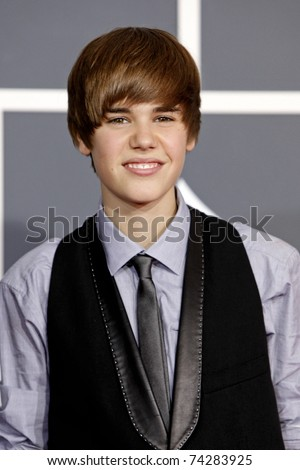 LOS ANGELES - JAN 31:  Justin Bieber arrives at the 52nd Annual GRAMMY Awards held at Staples Center in Los Angeles, California on January 31, 2010. - stock photo