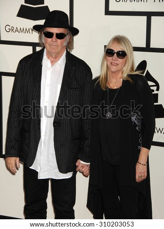 LOS ANGELES - JAN 26:  Neil Young and wife arrives at the 56th Annual Grammy Awards Arrivals  on January 26, 2014 in Los Angeles, CA                 - stock photo