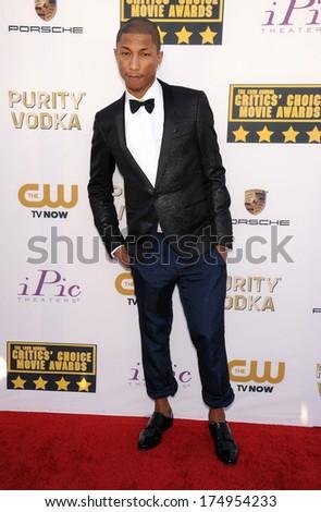 LOS ANGELES - JAN 16:  Pharrell Williams arrives to the Critics' Choice Movie Awards 2014  on January 16, 2014 in Santa Monica, CA                 - stock photo