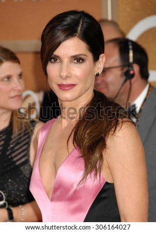 LOS ANGELES - JAN 12:  Sandra Bullock arrives to the 2014 Golden Globe Awards  on January 12, 2014 in Beverly Hills, CA                 - stock photo