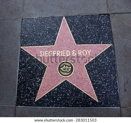 LOS ANGELES - JANUARY 23: Siegfried & Roy star Hollywood Walk of Fame, they are duo of magicians who became known for appearances with white lions, white tigers. January 23, 2014 Los Angeles, CA.  - stock photo