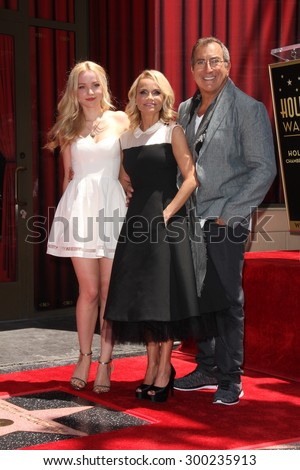 LOS ANGELES - JUL 24:  Dove Cameron, Kristin Chenoweth, Kenny Ortega at the Kristin Chenoweth Hollywood Walk of Fame Star Ceremony at the Hollywood Blvd on July 24, 2015 in Los Angeles, CA - stock photo