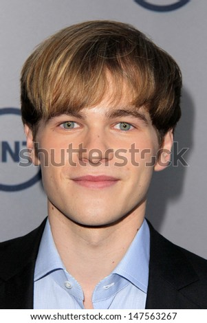 LOS ANGELES - JUL 24:  Graham Patrick Martin arrives at TNT's 25th Anniversary Party at the Beverly Hilton Hotel on July 24, 2013 in Beverly Hills, CA - stock photo