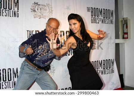 "LOS ANGELES - JUL 23:  Grand Master Eric Lee, Crystal Santos at the ""The Boom Boom Girls of Wrestling"" Premiere at the Downtown Independent Theater on July 23, 2015 in Los Angeles, CA - stock photo"