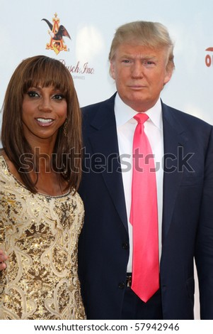 LOS ANGELES - JUL 24:  Holly Robinson Peete & Donald Trump arrives at  the 12th Annual HollyRod Foundation DesignCare Event at Ron Burkle's Green Acres Estate on July24, 2010 in Beverly Hills, CA .... - stock photo