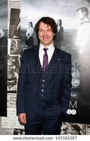 """LOS ANGELES - JUL 10:  John Gallagher Jr. arrives at the HBO series """"The Newsroom"""" Season 2 Premiere Screening at the Paramount Theater on July 10, 2013 in Los Angeles, CA - stock photo"""