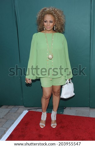 "LOS ANGELES - JUL 08:  Kim Fields arrives to the Hallmark's ""Northpole Christmas Celebration""  on July 08, 2014 in Beverly Hills, CA                 - stock photo"