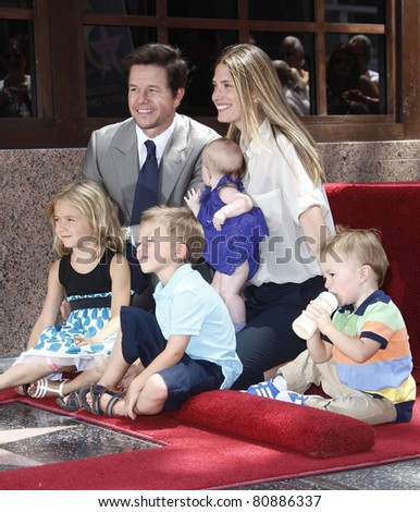 LOS ANGELES - JUL 29: Mark Wahlberg, wife Rhea Durham, their children Ella, Grace at a ceremony where Mark Wahlberg is honored with a star on the Hollywood Walk of Fame, California on July 29, 2010 - stock photo