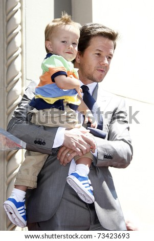 LOS ANGELES - JUL 29:  Mark Wahlberg, with son Brendan, arrives at a ceremony where he receives a star on the Hollywood Walk of Fame on July 29, 2010 in Los Angeles, California. - stock photo
