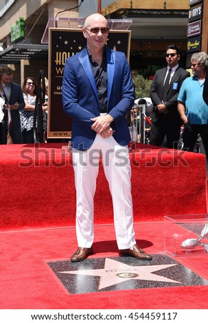 LOS ANGELES - JUL 15:  Pitbull aka Armando Christian Perez arrives to the Walk of Fame honors Pitbull on July 15, 2016 in Hollywood, CA                 - stock photo