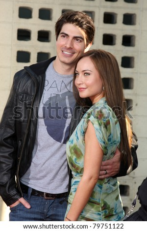 LOS ANGELES - JUN 21:  Brandon Routh, Courtney Ford arrive at the True Blood Season 4 Premiere at ArcLight Theater on June 21, 2011 in Los Angeles, CA - stock photo