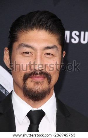 """LOS ANGELES - JUN 9:  Brian Tee at the """"Jurassic World"""" World Premiere at the Dolby Theater, Hollywood & Highland on June 9, 2015 in Los Angeles, CA  - stock photo"""