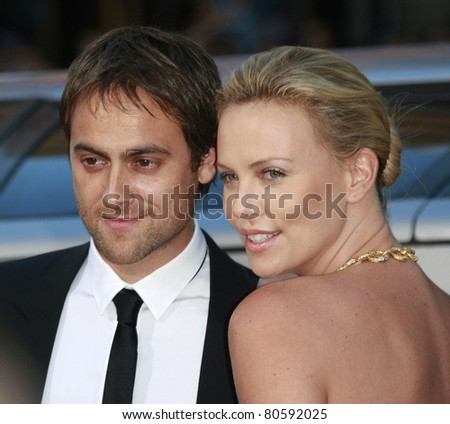 LOS ANGELES - JUN 30: Charlize Theron and Stuart Townsend at the premiere of 'Hancock' in Los Angeles, California on June 30, 2008 - stock photo