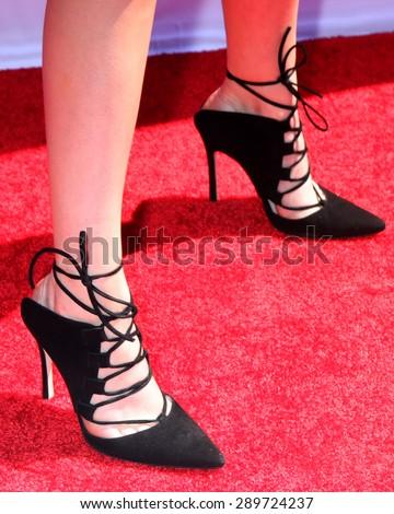 "LOS ANGELES - JUN 22:  Grace Phipps (shoe detail) at the ""Teen Beach 2"" Premiere  at the Walt Disney Studios on June 22, 2015 in Burbank, CA - stock photo"