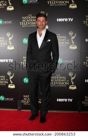 LOS ANGELES - JUN 22:  Greg Vaughn at the 2014 Daytime Emmy Awards Arrivals at the Beverly Hilton Hotel on June 22, 2014 in Beverly Hills, CA - stock photo