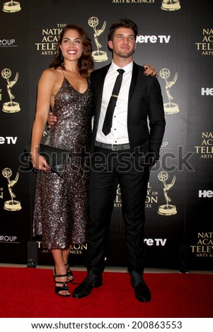 LOS ANGELES - JUN 22:  Kelly Thiebaud, Bryan Craig at the 2014 Daytime Emmy Awards Arrivals at the Beverly Hilton Hotel on June 22, 2014 in Beverly Hills, CA - stock photo