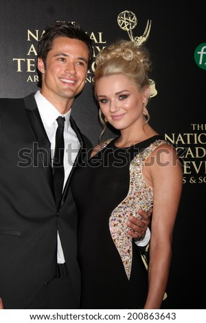 LOS ANGELES - JUN 22:  Matthew Atkinson, Hunter King at the 2014 Daytime Emmy Awards Arrivals at the Beverly Hilton Hotel on June 22, 2014 in Beverly Hills, CA - stock photo
