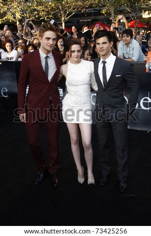 LOS ANGELES - JUN 24:  Robert Pattinson, Kristen Stewart, Taylor Lautner arrive at the premiere of 'The Twilight Saga: Eclipse' on June 24, 2010 at the Nokia Theater at LA Live in Los Angeles, CA - stock photo