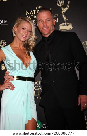 LOS ANGELES - JUN 22:  Suzanne Quast, Sean Carrigan at the 2014 Daytime Emmy Awards Arrivals at the Beverly Hilton Hotel on June 22, 2014 in Beverly Hills, CA - stock photo