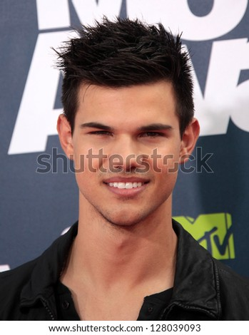 LOS ANGELES - JUN 05:  TAYLOR LAUTNER arriving to MTV Movie Awards 2011  on June 05, 2011 in Hollywood, CA - stock photo
