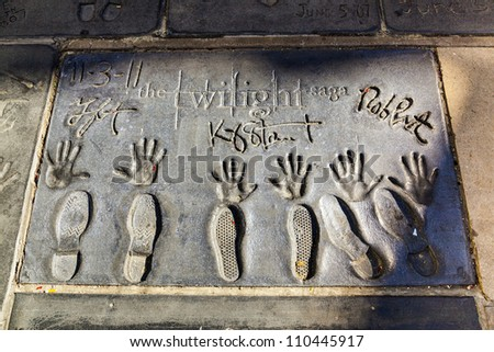LOS ANGELES - JUNE 26:  handprints of Twilight saga stars in Hollywood BLVD on June 26,2012 in Los Angeles. There are nearly 200 celebrity handprints in the concrete of Chinese Theatre's forecourt. - stock photo