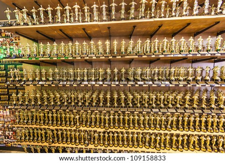 LOS ANGELES - JUNE 26: Oscar statues offered in shops inHollywood on June 26,2012 in Los Angeles. The first Academy Awards ceremony was held on May 16, 1929, at the Hotel Roosevelt in Hollywood. - stock photo