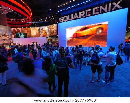 LOS ANGELES - June 17: People watching Square Enix video game presentation at E3 2015 expo. Electronic Entertainment Expo, commonly known as E3, is an annual trade fair for the video game industry - stock photo