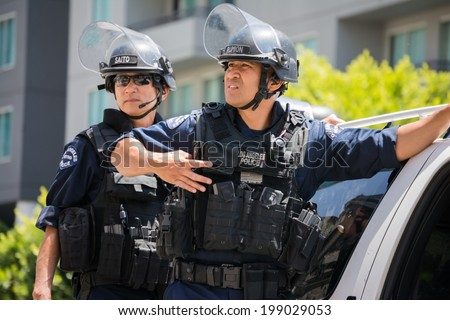 LOS ANGELES - JUNE 16, 2014: Police on the street during the LA Kings Stanley Cup Parade Celebration on June 16, 2014 in Los Angeles,CA - stock photo
