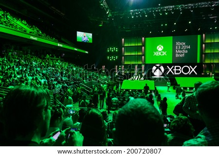 LOS ANGELES - JUNE 9:  Press gathered for Xbox One media briefing at E3 2014, the Expo for video games on June 9, 2014 in Los Angeles - stock photo