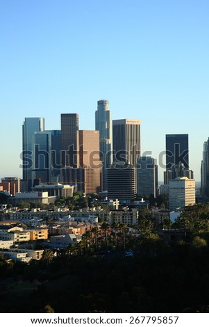 LOS ANGELES - JUNE 30: Skyscrapers and palm trees in Southern California on June 30, 2012 in Los Angeles. LA is the the most populous city in California and second-largest city in the United States. - stock photo