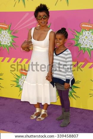 LOS ANGELES - MAR 23 - Angela Bassett and daughter arrives at the Nickelodeons 2013 Kids Choice Awards on March 23,  2013 in Los Angeles, CA              - stock photo