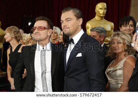 LOS ANGELES - MAR 2:  Bono, Leonardo DiCaprio at the 86th Academy Awards at Dolby Theater, Hollywood & Highland on March 2, 2014 in Los Angeles, CA - stock photo