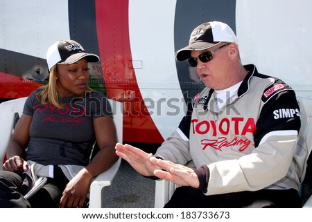 LOS ANGELES - MAR 15:  Carmelita Jeter, Al Unser Jr at the Toyota Grand Prix of Long Beach Pro-Celebrity Race Training at Willow Springs International Speedway on March 15, 2014 in Rosamond, CA - stock photo