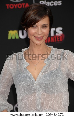 LOS ANGELES - MAR 11:  Catherine Bell arrives at the MUPPETS MOST WANTED LOS ANGELES PREMIERE  on March 11, 2014 in Los Angeles, CA                 - stock photo