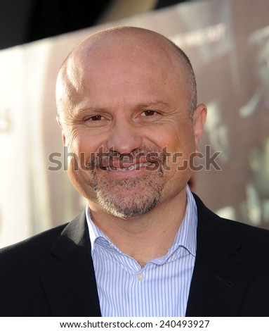 "LOS ANGELES - MAR 12:  Enrico Colantoni arrives to the """"Veronica Mars"" Los Angeles Premiere  on March 12, 2014 in Hollywood, CA                 - stock photo"