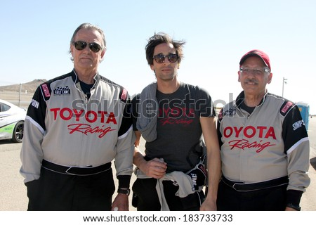 LOS ANGELES - MAR 15:  Eric Braeden, Adrien Brody, Dr. William Pinskyat the Toyota Grand Prix of LB Pro-Celebrity Race Training at Willow Springs Speedway on March 15, 2014 in Rosamond, CA - stock photo