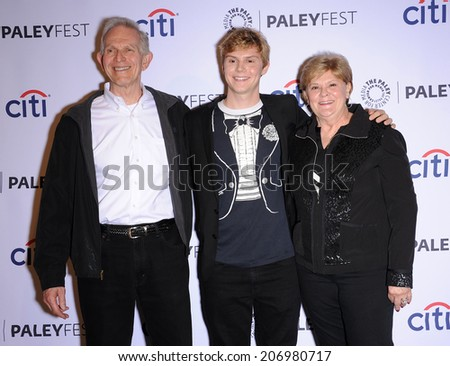 LOS ANGELES - MAR 28:  Evan Peters, Phil Peters & Julie Peters arrives to the Paleyfest 2014: American Horror Story COVEN  on March 28, 2014 in Hollywood, CA                 - stock photo