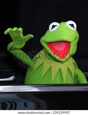 "LOS ANGELES - MAR 11:  Kermit the Frog at the ""Muppets Most Wanted"" - Los Angeles Premiere at the El Capitan Theater on March 11, 2014 in Los Angeles, CA - stock photo"