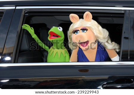 "LOS ANGELES - MAR 11:  Kermit the Frog, Miss Piggy at the ""Muppets Most Wanted"" - Los Angeles Premiere at the El Capitan Theater on March 11, 2014 in Los Angeles, CA - stock photo"